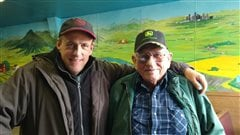 "Fimmaker Scott Parker, with Eastend, Saskatchewan farmer Herb Pidt from the film ""The Last One"", a segment in the Grasslands Project"