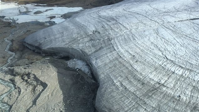 The process of dry calving is seen here in the broken off ice chunks at the base of this glacier. University of Calgary geographer Brian Moorman is working with the Canadian Space Agency to study the effects of dry calving on rising sea levels. Photo by Brian Moorman