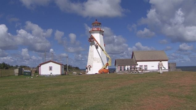Repainting of the *Confederation Lighthouse* is going on now and should take about two weeks, althoughl the winds are slowing things downs.