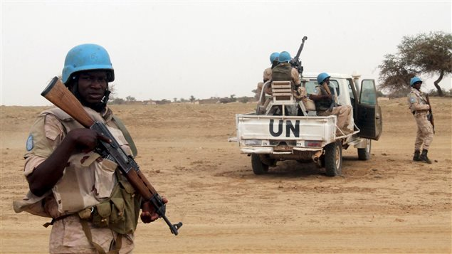 UN peacekeepers stand guard in the northern town of Kouroume, Mali, May 13, 2015. Kourome is 18 km (11 miles) south of Timbuktu.