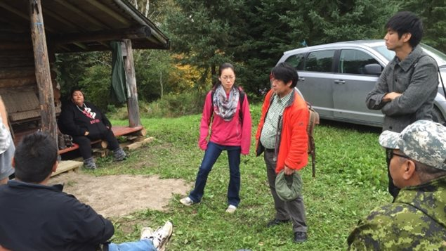 Dr. Masanori Hanada, centre, delivers the results of his study on mercury poisoning to people at Grassy Narrows First Nation.