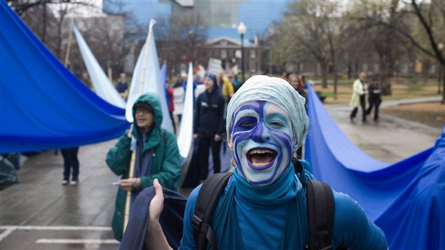 A demonstrator demands restitution for mercury poisoning at a Toronto march on April 7, 2010. The issue is not new.