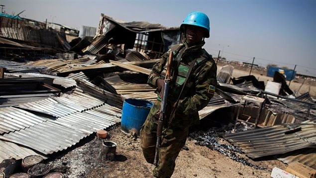 A UN peacekeeper from Rwanda walks through the remnants of a looted and burnt clinic in the UN Protection of Civilians (PoC) site in Malakal, on February 26, 2016.