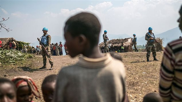 Indian peacekeepers stand guard at the Internally Displaced Persons Camp (IDPs) in Buleusa on July 16, 2016.