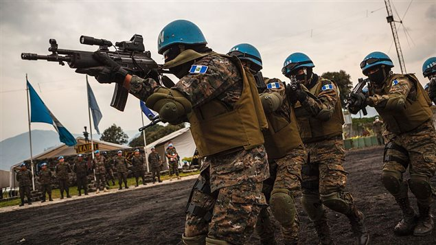 Members of the Guatemalan Special Forces 'Kaibil', stationed in the Democratic Republic of the Congo as part of the United Nations MONUSCO peacekeeping force, take part in a drill at the Guatemalan military base in Sake on July 12, 2016.