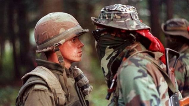 The most famous photo of the crisis, a Saskatchewan native, Brad Larocque, and Pte Patrick Cloutier. (the *warrior* is often mis-identified as Ronald *Lasagna* Cross, who later was charged and spent time in jail for his part in the crisis.