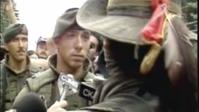 Sept 1, 1990 A Mohawk 'warrior* Ronald *lasagna* Cross, involved in a stare-down with a Canadian solider of the Royal 22e Regiment. The incident lasted only several seconds, Cross later telling reporters, **I just wanna look at their faces before I kill 'em.*