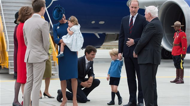 Prime Minister Justin Trudeau, centre, kneels to talk to Prince George as his father The Duke of Cambridge speaks with Governor General David Johnston, right, and The Duchess of Cambridge holds their daughter Princess Charlotte upon arrival in Victoria, B.C., on Saturday, September 24, 2016.