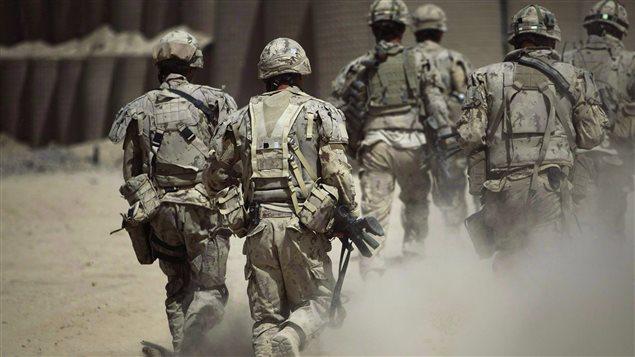 Canadian soldiers patrol southwest of Kandahar, Afghanistan, Monday, June 7, 2010.