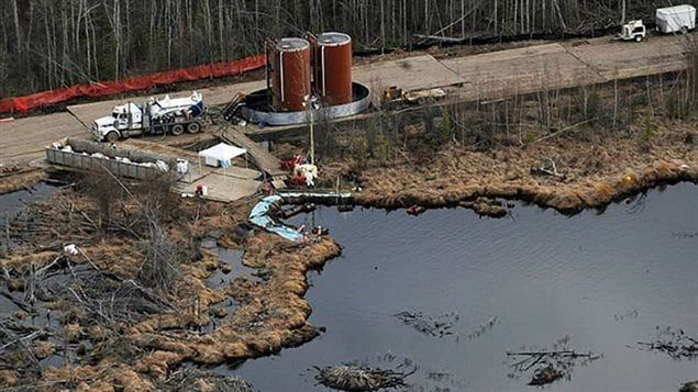 Crews clean up a pipeline break northeast of Peace River, Alta. on May 4, 2011. The spill was among the worst in Alberta's history.