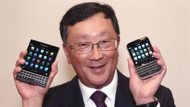 BlackBerry CEO John Chen shows off the Passport phone, left, and Classic phone models at the company's annual general meeting in June.