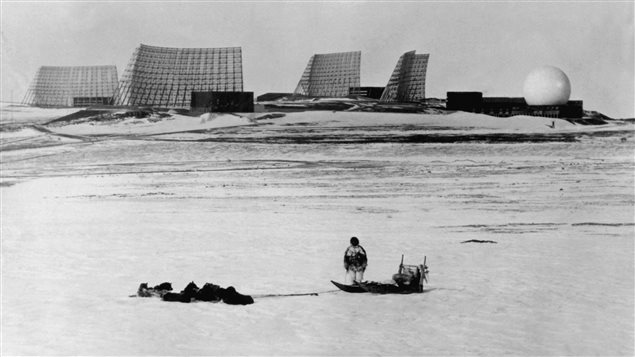 A Greenlander with his dog sleigh looks at the radars at Thule Air Base, about 250 kilometres from Camp Century, in Northern Greenland in 1966.