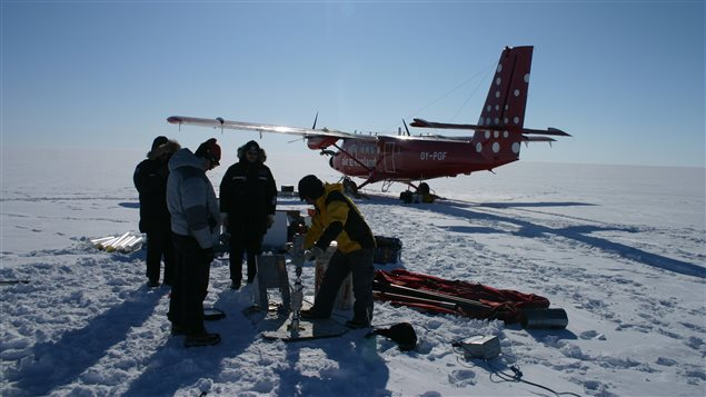 Climate and glacier scientists from the Lassonde school of engineering at Toronto's York University drill ice core samples in northwestern Greenlands above an abandoned U.S. base dug into the glacier.