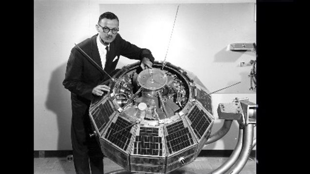 John Chapman Dr.John Chapman showing some of the internal electronics of Alouette-1 in 1962