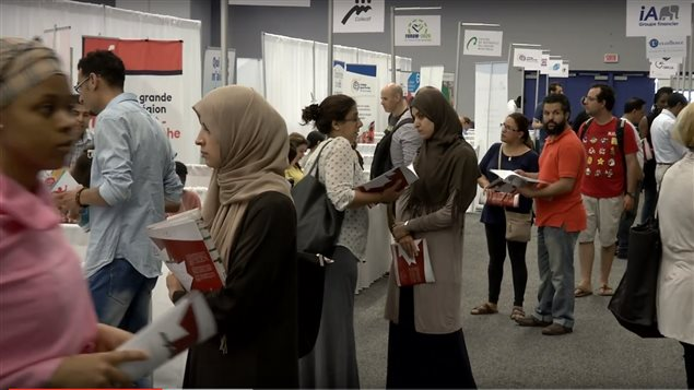 Participants of the first Maghreb fair organized by the Conseil des Maghreb au Canada browse through information booths of some of the companies presented at two-day event in 2015.