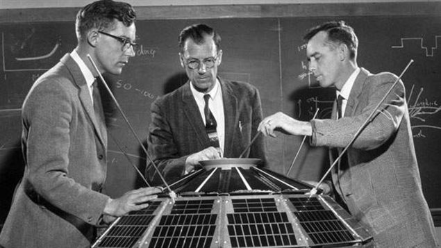Dr. Colin Franklin, Keith Brown and Dr. John Barry (left to right) with the Alouette- 1 satellite in April, 1961.