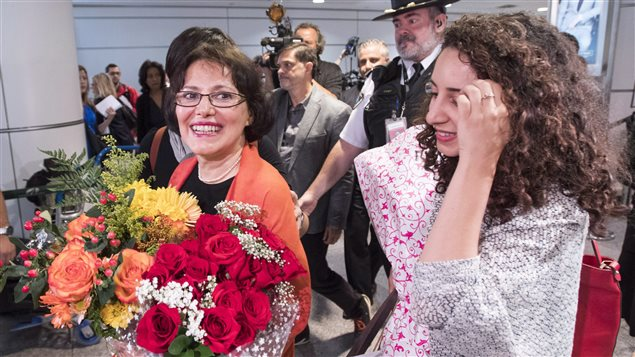 Homa Hoodfar, left, and her niece, Amanda Ghahremani, are greeted by friends and supporters as they arrive at Trudeau Airport Thursday, September 29, 2016 in Montreal. Hoodfar, a Canadian-Iranian academic was held in Iran's Evin prison for more than 100 days.