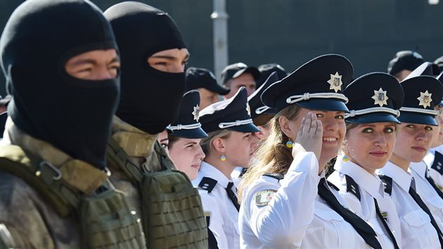 Police officers take part during National Police day celebrations in the centre of Kiev on August 4, 2016, marking the first anniversary of the new Ukrainian Police force .