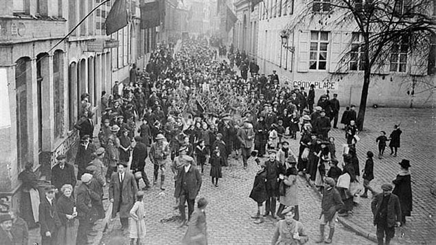 Canadian soldiers and joyful residents march through the streets of Mons, November 11th, 1918. Pte George Price was shot and died a few kilometers further east moments before the ceasefire came into effect.