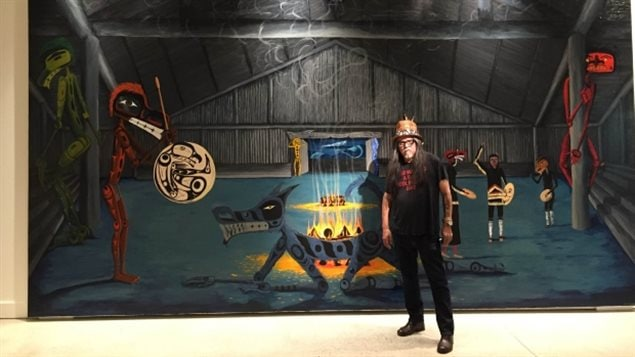 Artist Lawrence Paul Yuxweluptun stands before an exhibit of his work, Unceded Territories, at the University of British Columbia's Museum of Anthropology.