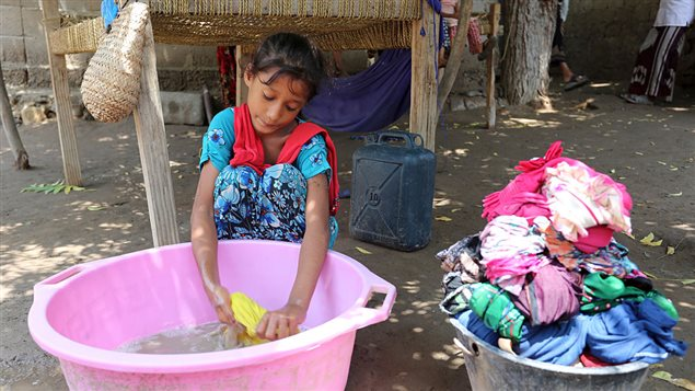 A Yemeni girl washes clothes on September 26, 2016 in an impoverished coastal village on the outskirts of Yemeni port city of Hodeida. The UNCEF data show that the disproportionate burden of domestic work begins early, with girls between five and nine years old spending 30 per cent more time on household chores than boys their age.