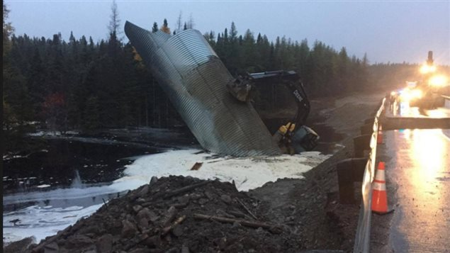 A portion of the Trans Canada Highway through Terra Nove National Park, was cut be flood waters as new construction and equipement were also washed out. The blockage will cause major supply problems for the captial St John's, and several communities.