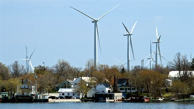 View of some of the dozens of turbines on Wolfe Island, Kingston Ontario.