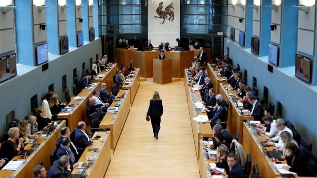 Le gouvernement de Wallonie a vot� contre l'entente estimant qu'elle menacerait les secteurs de l'agriculture et de l'industrie manufacturi�re.