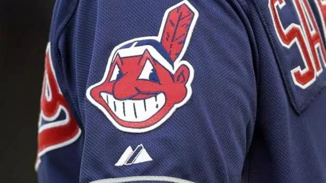 In this April 8, 2014 photo, the Cleveland Indians' Chief Wahoo logo is shown on a uniform sleeve.