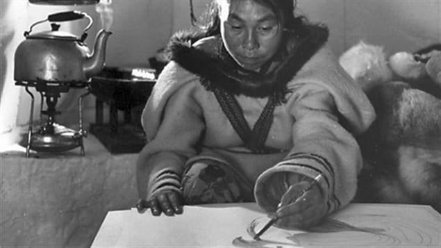 Photo from the National Film Board documentary on Ashevak showing her working and living in the traditional nomadic lifestyle in 1962, a few years before she and family moved into the community of Cape Dorset where she became a prolific and groundbreaking artist.
