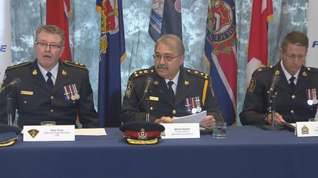 Woodstock police Chief William Renton, centre, speaks to reporters on Tuesday morning. Det. Sup. William Marylees of London police, right, and Det. Sup. Dave Truax of the OPP, left, are also pictured. (CBC)
