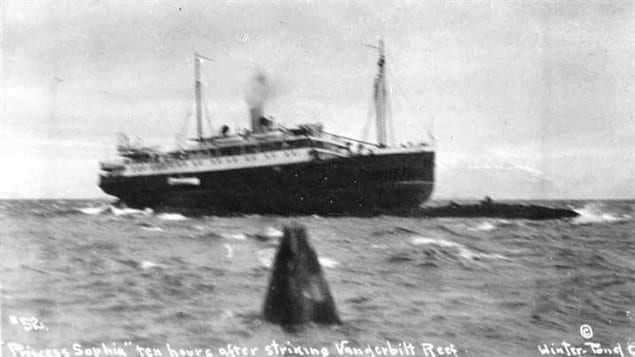October 24 1918, 11 AM: Sophia high on the reef. A lifeboat is lowered to allow inspection of the hull. It was decided that although enough ships were presnet to remove the passengers, it would have been very dangerous, and calmer weather was thought to be coming, so no attempt was made.