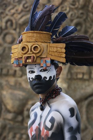 A man draws from his country's history to prepare for Mexico's Day of the Dead parade.