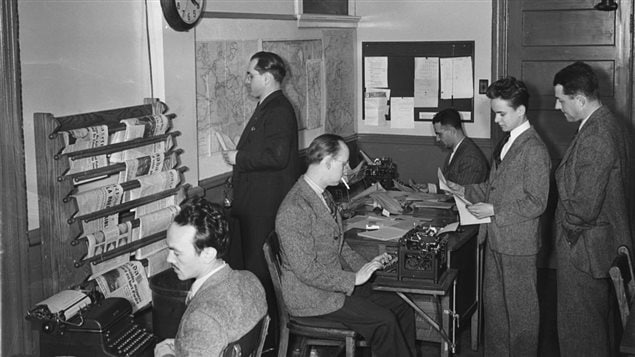 Journalists in the Radio-Canada newsroom in Montreal, July 1944. Smoking was common and acceptable in the workplace, but casual dress was not.