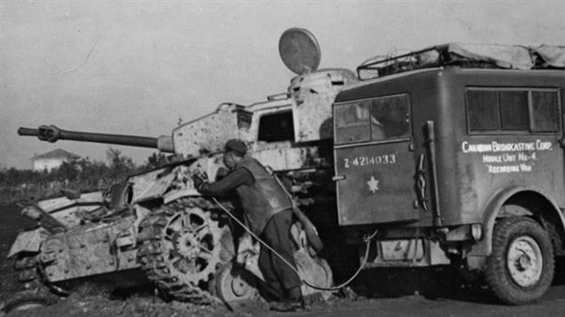 CBC reporter at the front in WWII with the specialized 8cwt Canadian designed Heavy Utility truck recording vehicle.