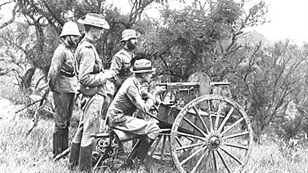 The 1895 Colt machine gun used by the RCD in South Africa. Photo shows British troops with the gun on it's carriage which could be pulled by a single horse.