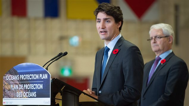 Prime Minister Justin Trudeau, left, announces a $1.5-billion national Oceans Protection Plan as Minister of Transport Marc Garneau listens, at HMCS Discovery in Vancouver, B.C., on Monday November 7, 2016.