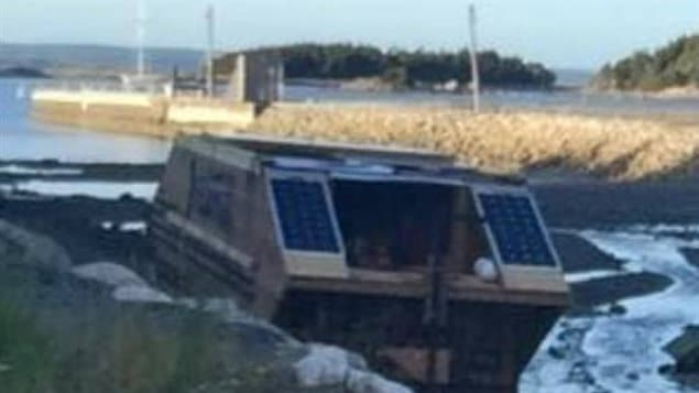 Timothy LeGrow of Conception Bay, Newfoundland, spotted this houseboat in a marine pond near his home.