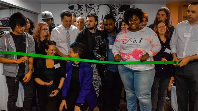 Team members, youth and supporters of Montreal's youth mental health centre cut the ribbon at the launch on November 9, 2016.