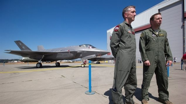 August 2016: Pilots Lt-Col. George Watkins, left, of the U.S. Air Force 34th Fighter Squadron, and Lt-Col. Curtis Pitts, of the 419th Fighter Wing, stand near one of two F-35A fighter aircraft after arriving Thursday for the Abbotsford International Airshow this weekend.
