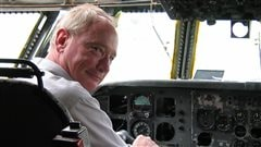 Chris Colton, executive director, sitting in the cockpit