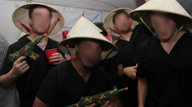 Some of the students dressed up as Viet Cong fighters wearing rice hats. (Twitter/CBC News)