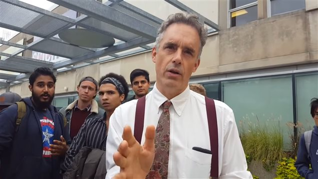 Video grab of Professor Peterson attempting to discuss and explain his position to an agitated crowd of  protestors