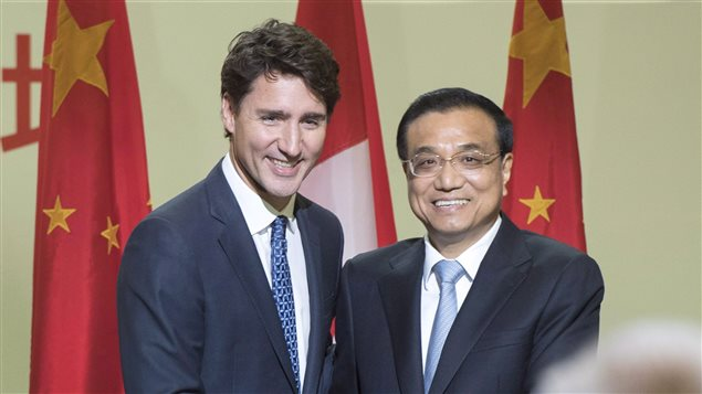 Chinese Premier Li Keqiang, and Canadian Prime Minister Justin Trudeau shake hands after speaking to a business luncheon Friday, September 23, 2016 in Montreal.