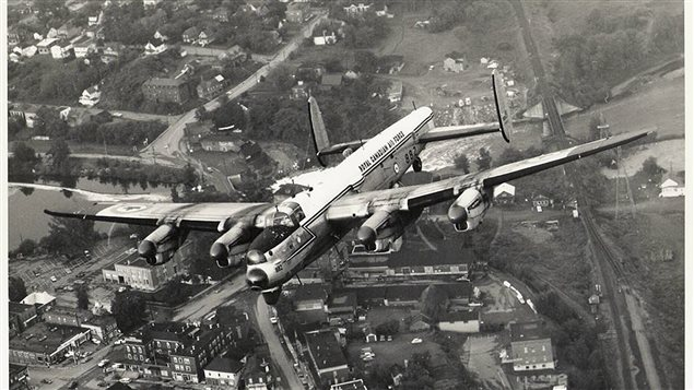 Lancaster KB882 flies over Edmundston, New Brunswick, on its final flight on July 14, 1964. the aircraft was parked and remained outdoors ever since, slowly deteriotating. News this week it will be collected by the National Air Force Museum in Trenton Ontario, and fully restored to its poswar reconnaissance role for display purposes, indoors.