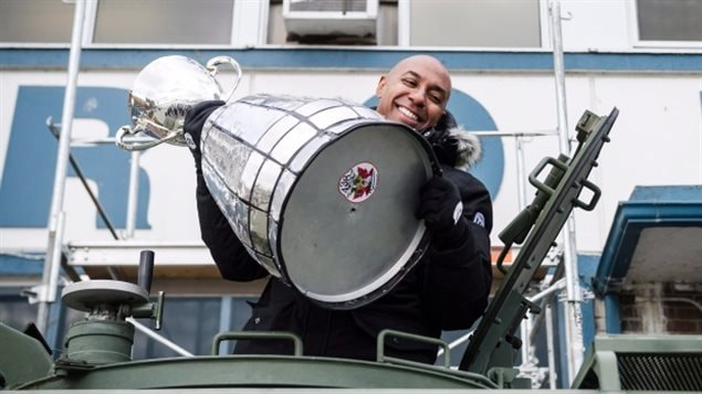 CFL commissioner Jeffrey Orridge and the Grey Cup arrive via armoured military vehilce to a ceremony on Toronto's waterfront this week