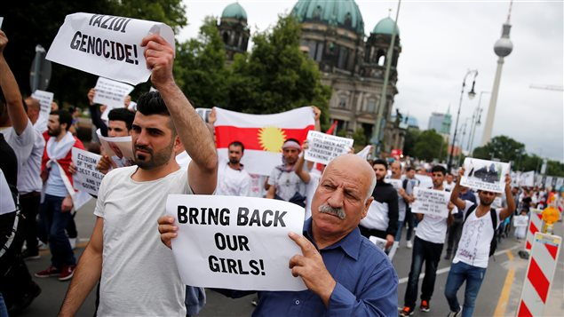 People attend a demonstration in Berlin to mark the second anniversary of the Sinjar massacre and what a U.N.-appointed commission of independent war crimes investigators termed a genocide against the Yazidi population by the Islamic State, Germany, August 3, 2016.