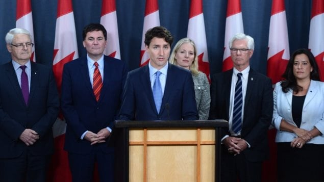 Prime Minister Justin Trudeau holds a press conference at the National Press Theatre in Ottawa on Tuesday, Nov. 29, 2016. Trudeau is approving Kinder Morgan's proposal to triple the capacity of its Trans Mountain pipeline from Alberta to Burnaby, B.C. — a $6.8-billion project that has sparked protests by climate change activists.