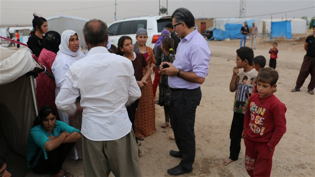 Dr. Jan Kizilhan (centre) talks to a group of Yazidi refugees in Northern Iraq.