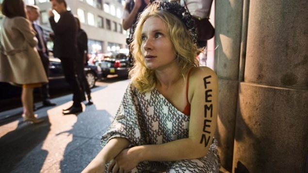 FEMEN activist Kseniya Chernyshova says in a Facebook post that she intends to fight charges of prostitution pressed against her by New York City police.